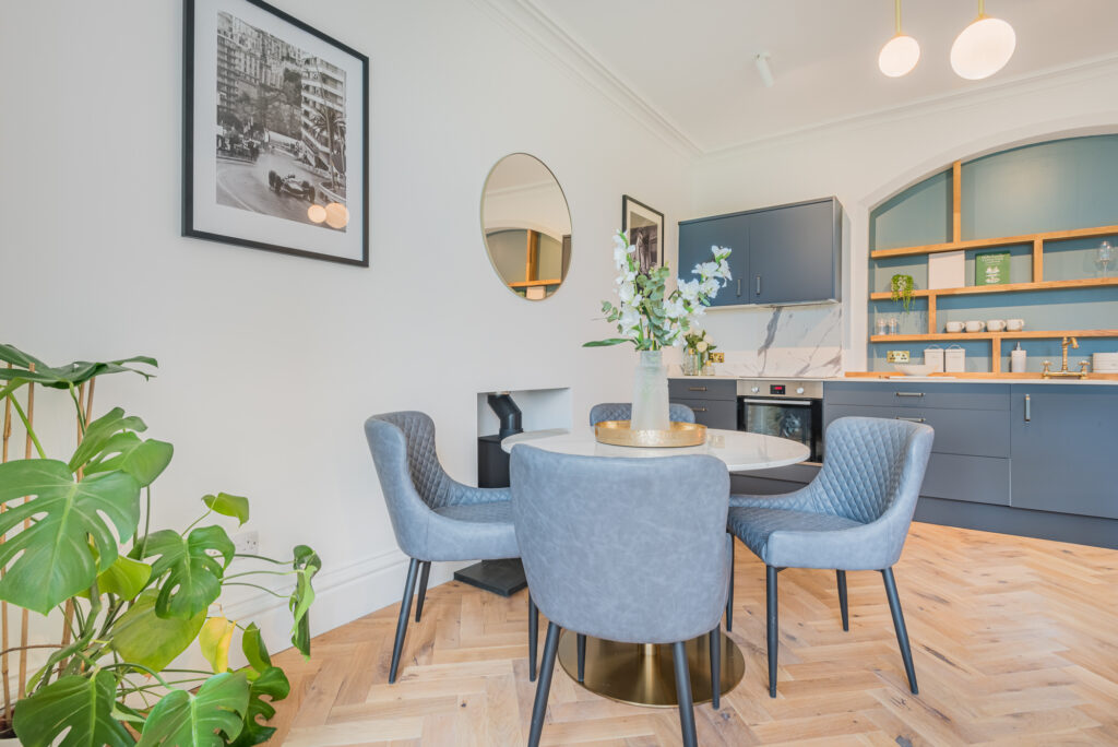 A beautifully styles grey/blue themed dining/kitchen space
